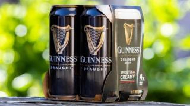 Guinness cans in cardboard box