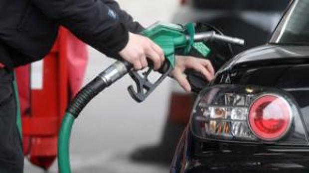 Driver fills up at petrol pump
