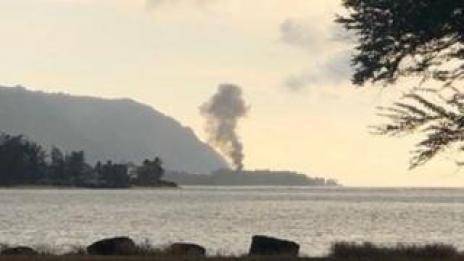 A plume of smoke rises after an airplane crash, seen from Kaiaka Bay Beach Park, in Haleiwa, Hawaii, U.S., June 21, 2019 in this image obtained from social media.