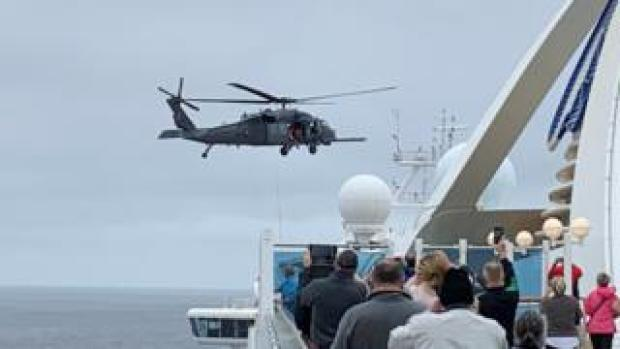 A helicopter hovers above the Grand Princess cruise ship, 5 March