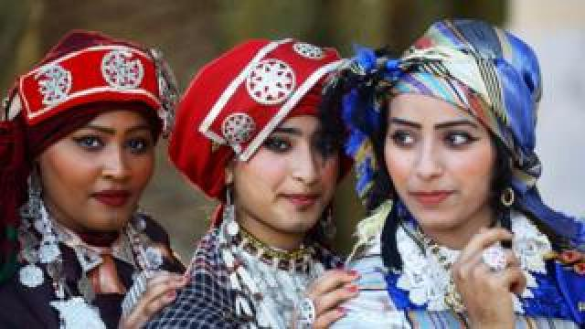 Libyan girls attend the national day of the Libyan costume at the Martyrs Square in the capital Tripoli, on March 13, 2019