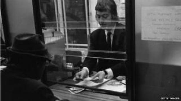 Bank cashier circa 1972