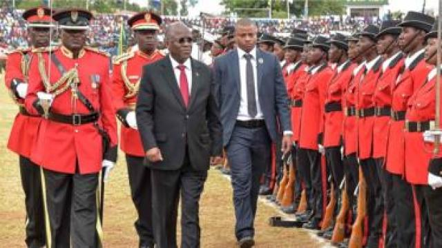 President John Magufuli reviews an honour guard of troops as he attends a ceremony marking the Tanzania's 56th independence anniversary in Dodoma on December 9, 2017.