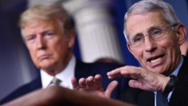 Dr Anthony Fauci speaks as US President Donald Trump listens during the daily press briefing