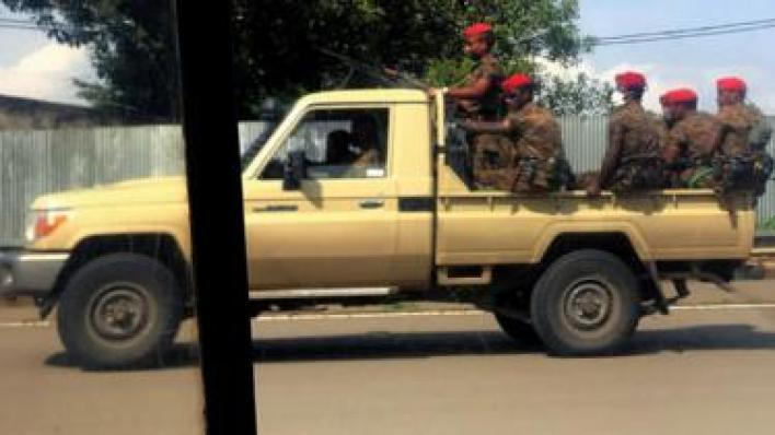 Ethiopian soldiers ride on their pick-up truck as they patrol the streets following protests in Addis Ababa - July 2020