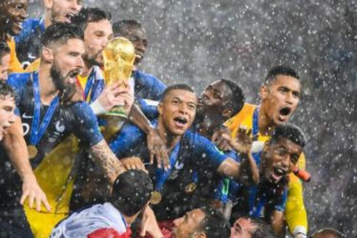 France's players lift the World Cup trophy after winning the Russia 2018 World Cup final football match between France and Croatia at the Luzhniki Stadium in Moscow on July 15, 2018.