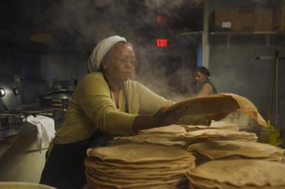 Zenebech Dessu prepares injera, an East African sourdough-risen flatbread at her Zenebech Restaurant in Shaw