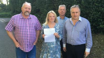 Vaughan Evans, Bernadette Loader, Emlyn Williams and Hywel Hughes who are opposed to Parc Solar Traffwll on Anglesey