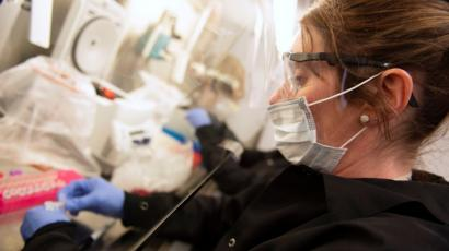 A female scientist in a coronavirus testing lab