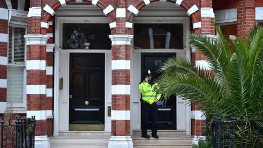 A police officer outside the flat where Palmer-Tomkinson's body was found