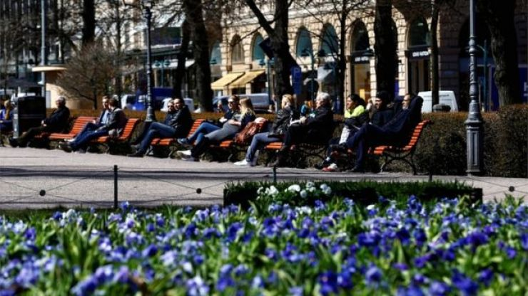 People enjoy a sunny day on the Esplanade in Helsinki, Finland, in May 2017