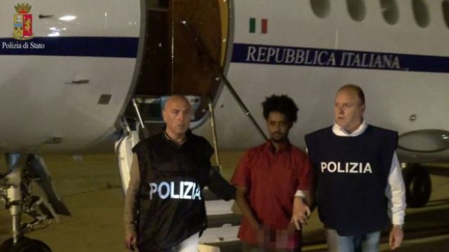 A police photo shows a people smuggling suspect arriving on Italian soil (8 June)