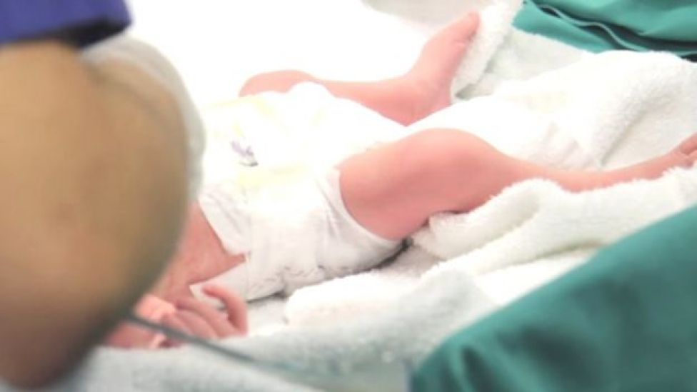 Screengrab from hospital video showing one of newborn twins