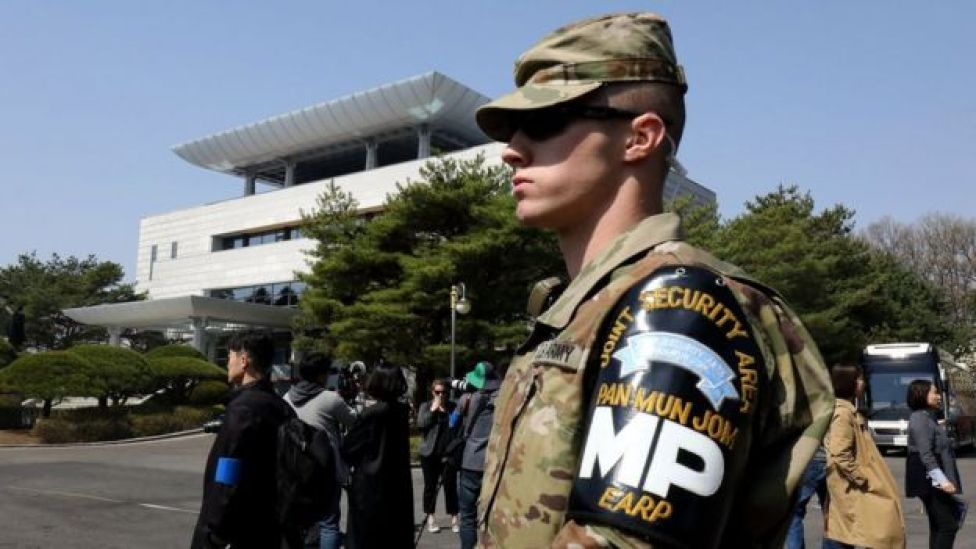 A US soldier stands guard in front of the Peace House in the demilitarized Zone between South and North Korea