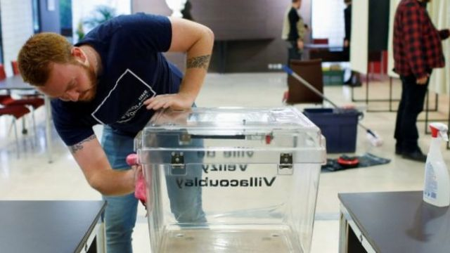 French employee cleans ballot box ahead of local elections - 14 March