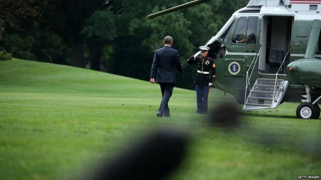 US President Barack Obama walks towards the Marine One prior to his departure from the White House 31 August 2015 in Washington, DC.