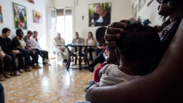 Pope Francis talks to former prostitutes at an apartment for former prostitutes in Rome, Italy