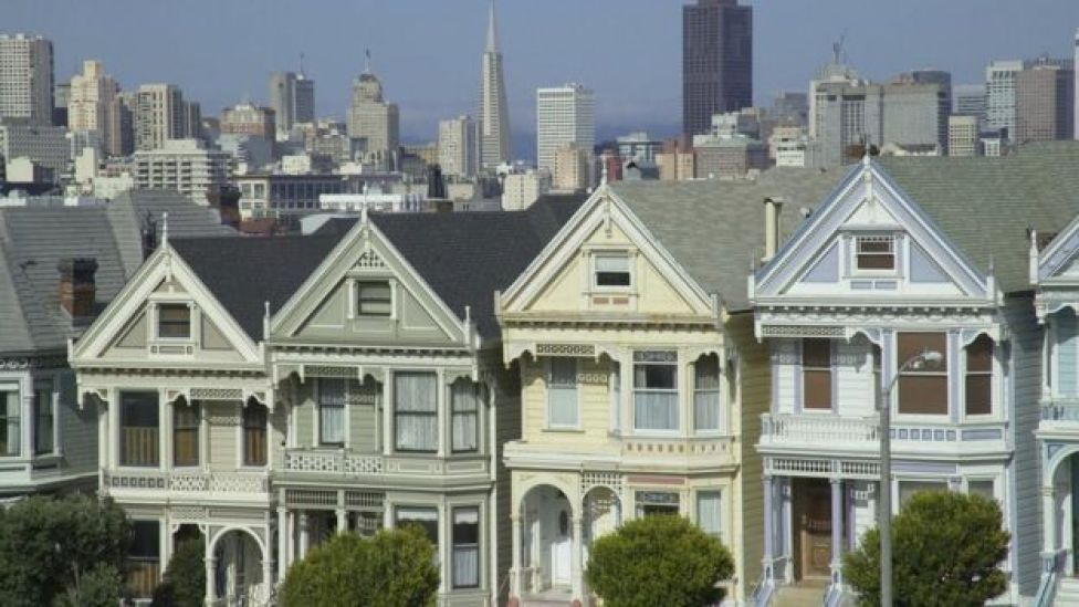 Painted Ladies in Alamo Square, Victorian-style houses in the residential area of San Francisco with downtown in the background,