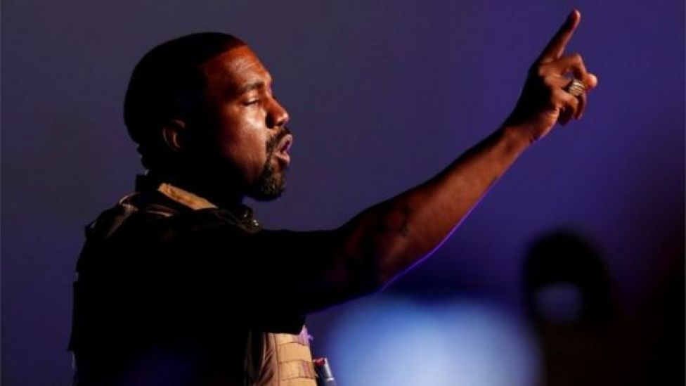 Kanye West gestures at his first rally for US president