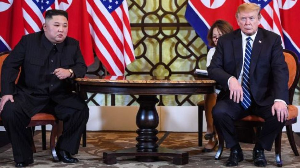 US President Donald Trump (R) holds a meeting with North Korea's leader Kim Jong-un