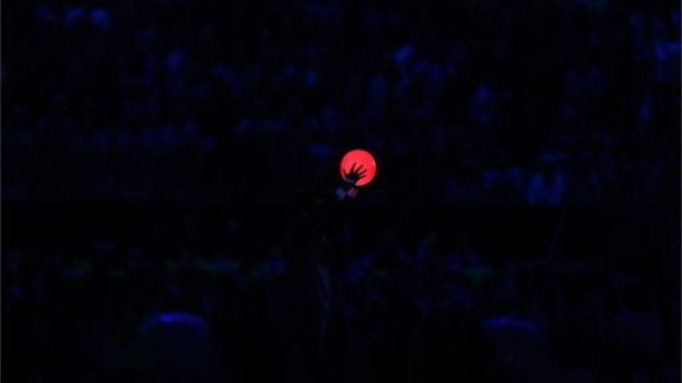 Japanese Prime Minister Shinzo Abe holds up a ball duirng the flag handover segment during the Closing Ceremony on Day 16 of the Rio 2016 Olympic Games at Maracana Stadium on August 21, 2016 in
