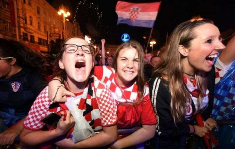 Croatia's supporters celebrate a goal as they watch Croatia -V-England at the main square in Zagreb