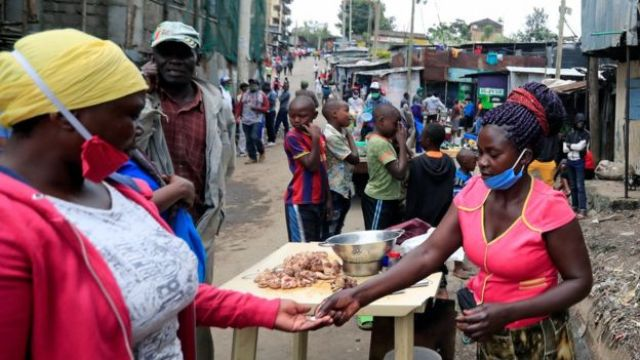 Woman selling chicken