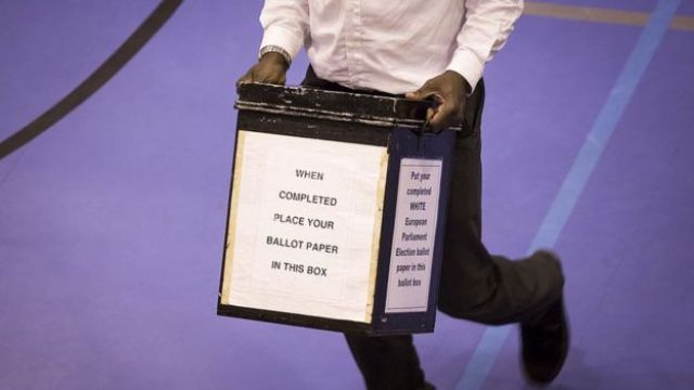 A ballot box containing votes in the European elections arrives at Trinity School on May 22, 2014 in Croydon, England.