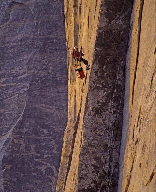 Alex Lowe climbing a rock face