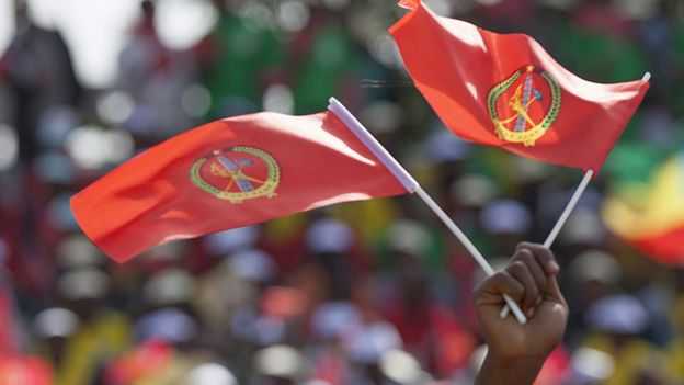 Someone waves the Ethiopian People's Revolutionary Democratic Front flag in front of a large crowd during an election rally in May 2015, Addis Ababa