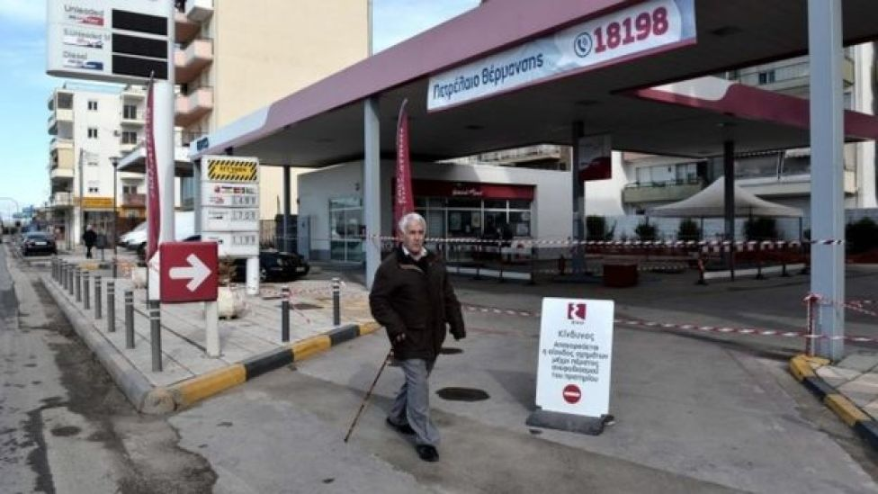 A man walks next to a petrol station where the unexploded bomb was found in Thessaloniki (08 February 2017)