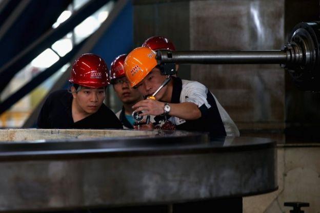 Operários chineses