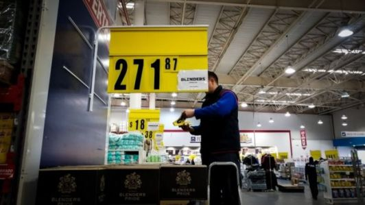 A supermarket employee changes products' price tags due to inflation, in Buenos Aires, Argentina, 14 August 2019