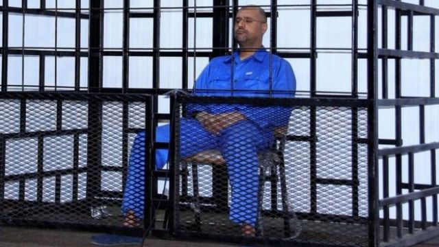 Saif al-Islam Gaddafi, son of late Libyan leader Muammar Gaddafi, attending a hearing behind bars in a courtroom in Zintan May 25, 2014