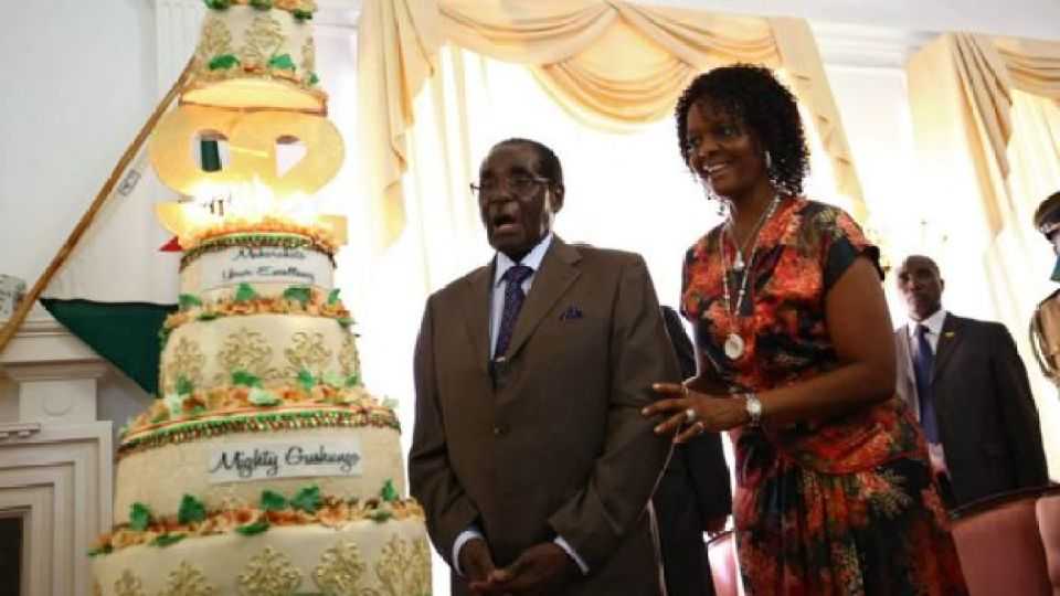 Zimbabwean President Robert Mugabe (L) with his wife Grace (R) cut a piece of cake during his birthday event at state house in Harare, Zimbabwe, 22 February 2016