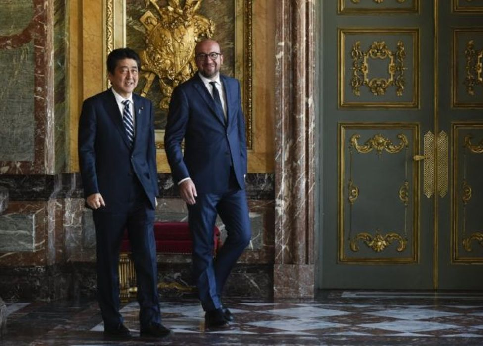 Belgian Prime minister Charles Michel (R) arrives with Japan's Prime Minister Shinzo Abe (L) before their meeting in Brussels, Belgium, 5 July 2017