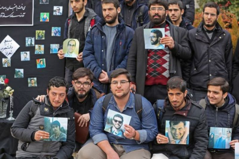 Iranian students hold pictures of victims during a memorial for the passengers of the Ukraine plane crash, in University of Tehran on January 14, 2020