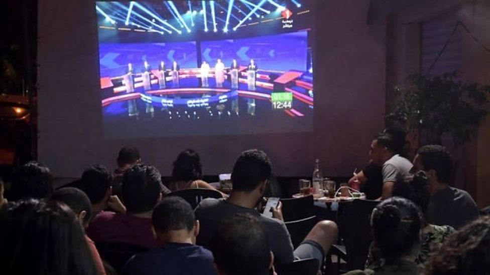 People watch the presidential TV debate in a cafe in Tunis on 7 September, 2019