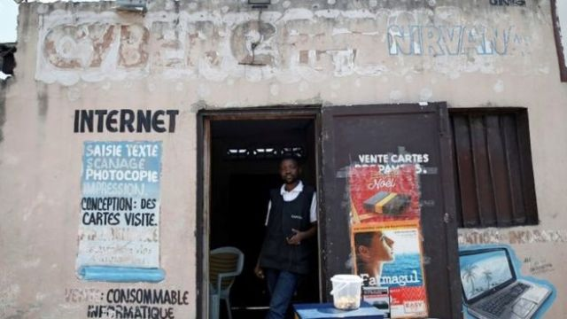 Congolese internet cafe owner Theo stands at the entrance of his empty business in Kinshasa, Democratic Republic of Congo, January 7, 2019