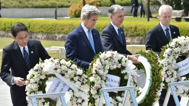 Japan's Foreign Minister Fumio Kishida, US Secretary of State John Kerry, British Foreign Secretary Philip Hammond and Canada's Foreign Minister Stephane Dion lay wreaths at the Hiroshima memorial