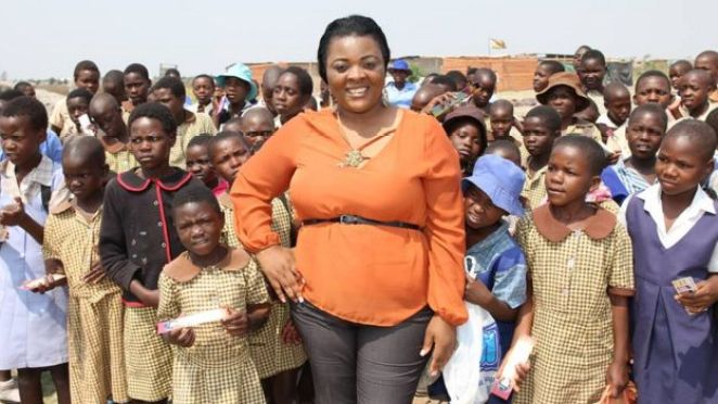 Marie-Claire Nabila Kuja stands with a group of girls in Cameroon.