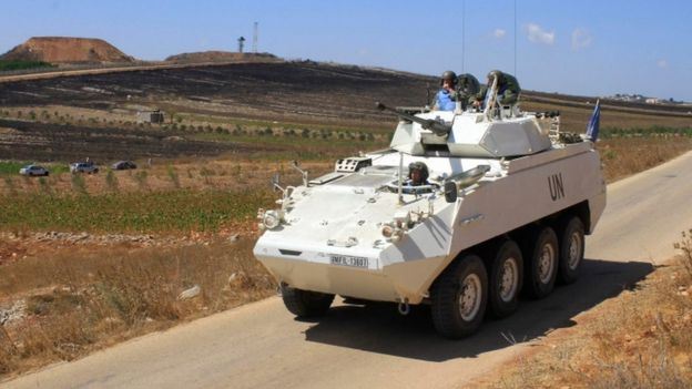 United Nations peacekeeping forces patrol a road near the Israeli-Lebanese border