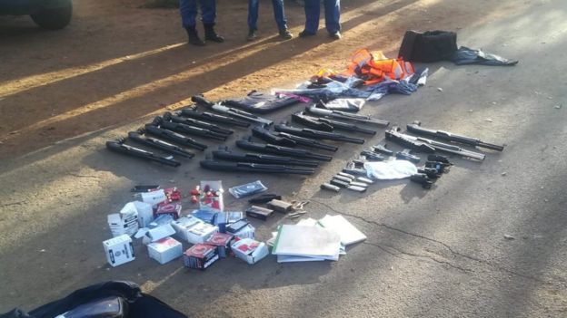 Seized guns laid out on the road by police