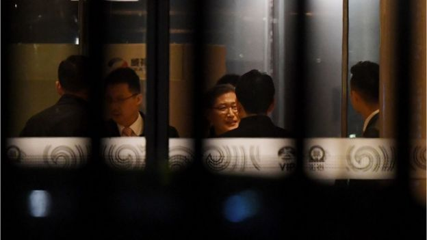 North Korean and Chinese officials gather at the VIP entrance at Beijing airport after the arrival of flight MH360 from Malaysia early on 31 March 2017.