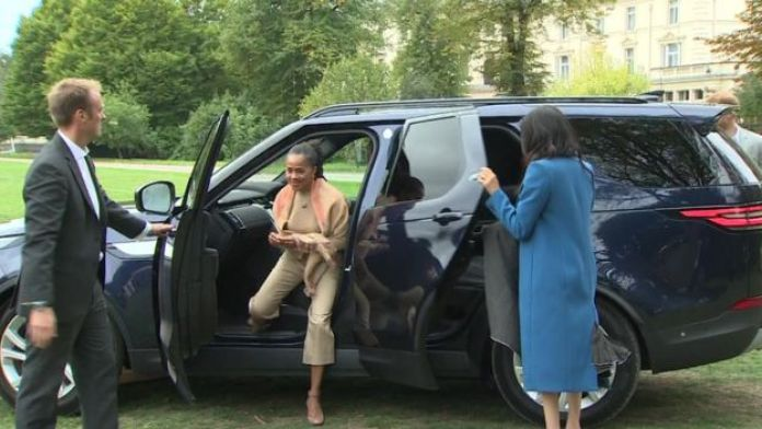 The Duchess shuts her own door as she arrives at a cookbook launch with her mother Doria Ragland