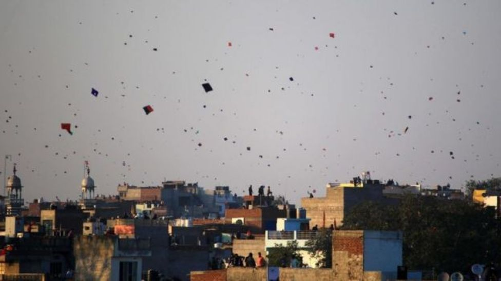 Hundreds of kites fill the sky over the Indian city of Jaipur
