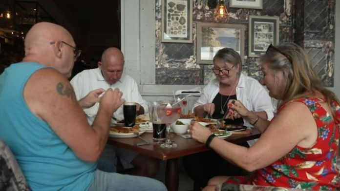 Diners at the Spyglass and Kettle pub
