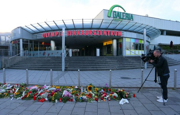 Flowers laid in front of the Olympia shopping mall in Munich, Germany, 23 July