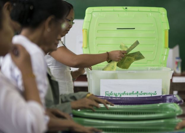 In this photo taken late 8 November 2015, election commission officials count votes at a polling station in Mandalay.