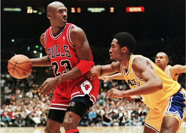 Michael Jordan being guarded by Kobe Bryant of the Los Angeles Lakers
